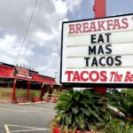 "tornado taco in spring branch sign says ""eat mas tacos"""